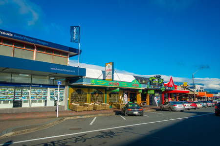 NORTH ISLAND, NEW ZEALAND- MAY 18, 2017: Taupo is a town on the shore of Lake Taupo in the centre of the North Island of New Zealand. Some cars parked outside of a store