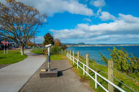 NORTH ISLAND, NEW ZEALAND- MAY 18, 2017: Beautiful view of wharf, and lovely view of Lake Taupo with mountains an city in the background at spring, North Island of New Zealand with beautiful blue sky