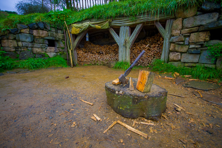 NORTH ISLAND, NEW ZEALAND- MAY 16, 2017: Site with trunks with a hatchet in a Hobbiton movie set, site made for movies: Hobbit and Lord of the ring in Matamata, north island of New Zealand
