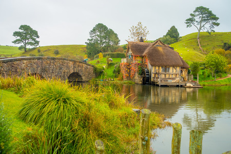 NORTH ISLAND, NEW ZEALAND- MAY 16, 2017: Water mill in Hobbiton, site made for movies: Hobbit and Lord of the ring in Matamata, north island of New Zealand