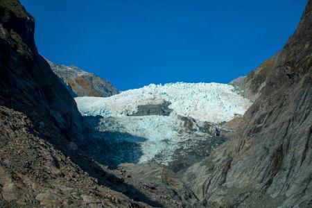 molly: Franz Josef Glacier and valley floor, Westland, South Island, Franz Josef Glacier National Park, in New Zealand Stock Photo