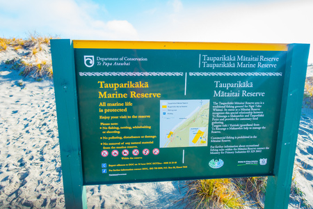 bushwalk: SOUTH ISLAND, NEW ZEALAND- MAY 23, 2017: Informative sign of marine reserve located in South Island in New Zealand