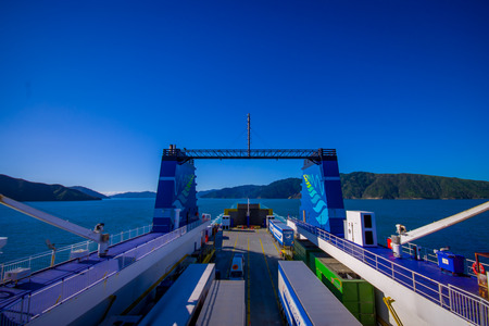 SOUTH ISLAND, NEW ZEALAND- MAY 25, 2017: Ferry at harbour that provide daily connection between North and South islands with a beautiful blue sky located in New Zealand