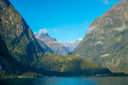 mitre: landscape of high mountain glacier at milford sound with a beautiful lake, in south island in New Zealand