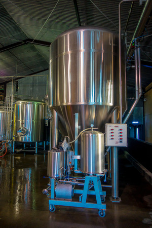 brasserie: SOUTH ISLAND, NEW ZEALAND- MAY 25, 2017: Modern Beer Factory, steel tanks for beer fermentation and maturation, monteiths beer factory, south island in New Zealand