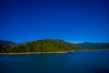 Beautiful landscape with gorgeous blue sky in a sunny day seen from ferry from north island to south island, in New Zealand. Stock Photo
