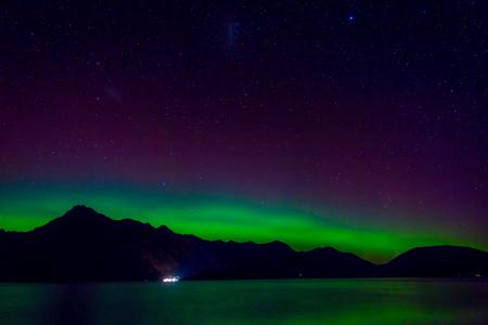 Beautiful Aurora Australis and milky way over Lake Wakatipu, Kinloch, New Zealand South Island