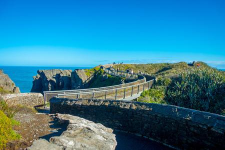 geological formation: Brindge over a grand canyon Pancake Rocks Punakaiki, West Coast, South Island, New Zealand Stock Photo