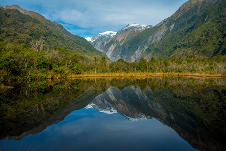 franz: Small pond peters pond with reflection of mountain glacier Franz Josef Glacier in New Zealand