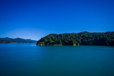 marlborough: Beautiful landscape of mountain with gorgeous blue sky in a sunny day seen from ferry from north island to south island, in New Zealand