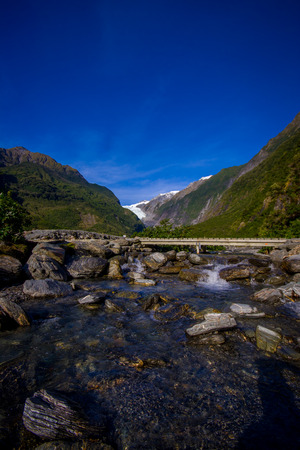 Beautiful view of Franz Josef Glacier in Westland National Park on the West Coast of South Island. Southern Alps mountains