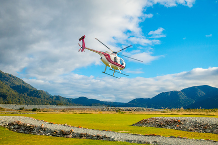 SOUTH ISLAND, NEW ZEALAND- MAY 25, 2017: A helicopter lifting off ready to take tourists to a glacier in the South Island of New Zealand