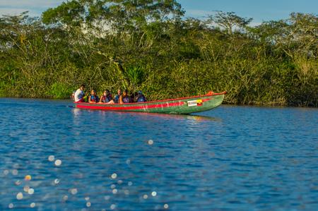 CUYABENO, ECUADOR - NOVEMBER 16, 2016: Unidentified people travelling by boat in Cuyabeno National Park, Ecuador Editorial