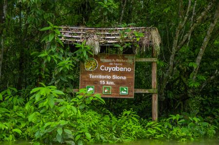 CUYABENO, ECUADOR - NOVEMBER 16, 2016: An informative wooden sign about the Cuyabeno National Park, depth of Amazon Jungle, in Ecuador Editorial