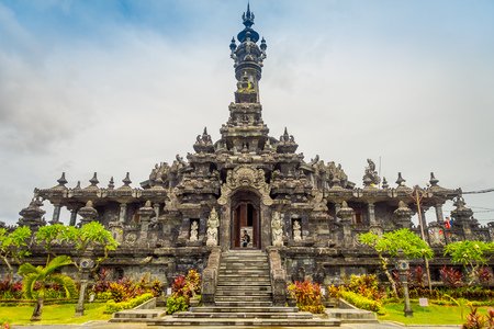 BALI, INDONESIA - MARCH 08, 2017: Panoramic landscape traditional balinese hindu temple Bajra Sandhi monument in Denpasar, Bali, Indonesia on background tropical nature and blue summer sky, Indonesia Banco de Imagens