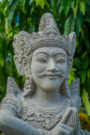 antiquity: BALI, INDONESIA - MARCH 08, 2017: Close up of a beautiful stone statue inside of the Royal temple of Mengwi Empire located in Mengwi in Bali, Indonesia Editorial