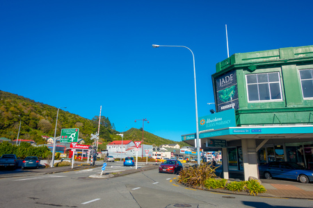 shantytown: SOUTH ISLAND, NEW ZEALAND- MAY 23, 2017: Unidentified people walking in the street in main South Road, Greymouth, New Zealand