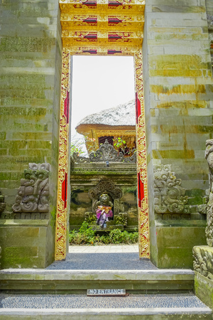 antiquity: BALI, INDONESIA - APRIL 05, 2017: Gate to enter to Ubud temple in Bali, Indonesia