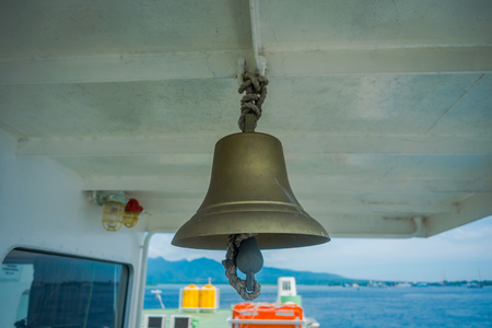 chillout: BALI, INDONESIA - APRIL 05, 2017: Close up of a bell in ferry Banyuwangi Gilimanuk, with a beautiful blue sky located in Ubud, Bali in Indonesia Editorial