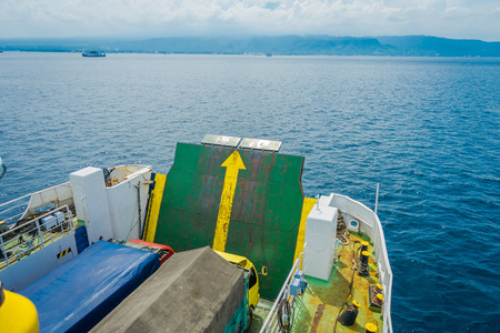 ubud: BALI, INDONESIA - APRIL 05, 2017: Door closed in ferry Banyuwangi Gilimanuk, with a beautiful blue sky located in Ubud, Bali in Indonesia