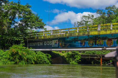 CUYABENO, ECUADOR - NOVEMBER 16, 2016: Bridge over the Cuyabeno River with a pipeline suspended beside it, Cuyabeno National Park in Ecuador