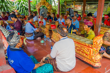 ubud: BALI, INDONESIA - APRIL 05, 2017:Unidentified people resting inside of a building in the beautiful temple in Ubud Bali located in Indonesia Editorial