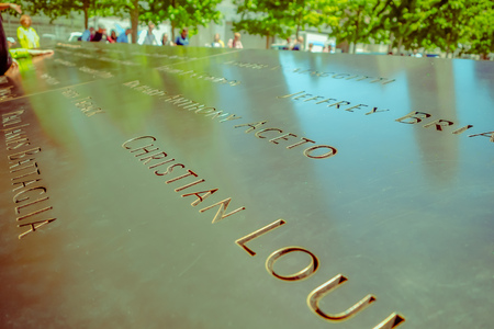 NEW YORK, USA - NOVEMBER 22, 2016: Text close up on Memorial 9-11 monument in Manhattan after the attempted against twin towers in new York Usa. 에디토리얼