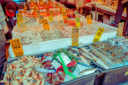 NEW YORK, USA - NOVEMBER 22, 2016: A sidewalk produce stand in China Town, seafood in New York City, Chinatown is home to the largest amount of Chinese people in the Western hemisphere.