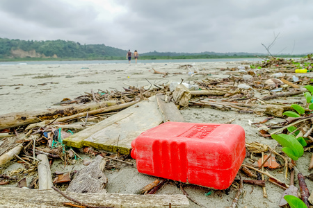 MUISNE, ECUADOR- MAY 06, 2017: Beach pollution with garvage and trash on the beach causing damage to the environment in Muisne Island in Ecuador Editorial