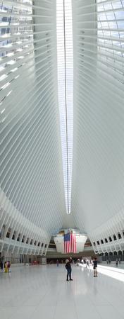 NEW YORK, USA - MAY 05, 2017: Unidentified people looking up at the interior of Santiago Calatravas Oculus New York, the multi-billion dollar transportation hub in lower Manhattan in New York Usa.