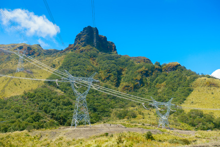 Beautiful landscape of Papallacta mountains in a sunny day with electrict towers in Quito Ecuador