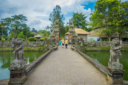 People walking inside of the temple of Mengwi Empire located in Mengwi, Badung regency that is famous places of interest in Bali, Indonesia Stock Photo