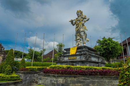 BALI, INDONESIA - MARCH 08, 2017: Stone statue of Vishnu in Gunung Kawi, Bali, Indonesia Editorial