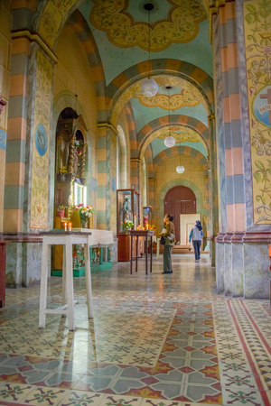 QUITO, ECUADOR - NOVEMBER 23, 2016: Unidentified woman inside of the Church and Convent of Saint Francis Editorial