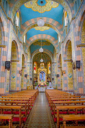 QUITO, ECUADOR - NOVEMBER 23, 2016: Interior of the Church and Convent of Saint Francis, with chairs an spiritual images