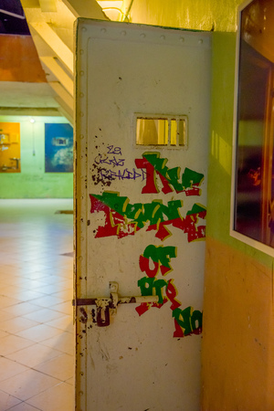 QUITO, ECUADOR - NOVEMBER 23, 2016: Art with words in the doors inside of the prison, in the old prison Penal Garcia Moreno in the city of Quito