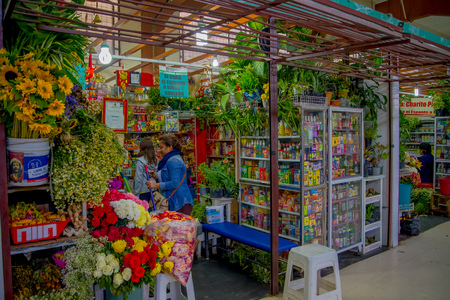 QUITO, ECUADOR - NOVEMBER 23, 2016: A flower market with some naturist medicine at the municipal market located in San Francisco in Quito city Editorial