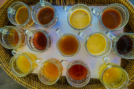 Kopi Luwak coffee and tea testing, in Bali Island in Indonesia, above view Stock Photo
