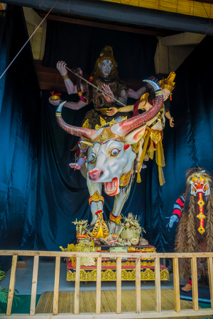 even: BALI, INDONESIA - MARCH 08, 2017: Impresive hand made structure, Ogoh-ogoh statue built for the Ngrupuk parade, which takes place on the even of Nyepi day in Bali, Indonesia. A Hindu holiday marked by a day of silence