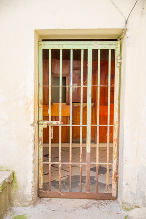 penal: Indoor view with a door with bars, in the old prison Penal Garcia Moreno in the city of Quito Stock Photo