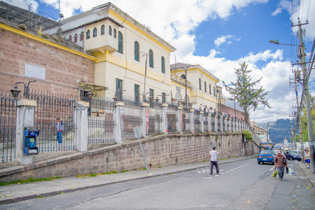 lock block: QUITO, ECUADOR - NOVEMBER 23, 2016: Unidentified people walking at outside, in the old prison Penal Garcia Moreno in the city of Quito Editorial