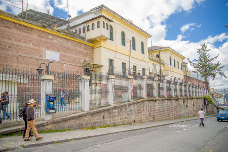 QUITO, ECUADOR - NOVEMBER 23, 2016: Unidentified people walking at outside, in the old prison Penal Garcia Moreno in the city of Quito Editorial