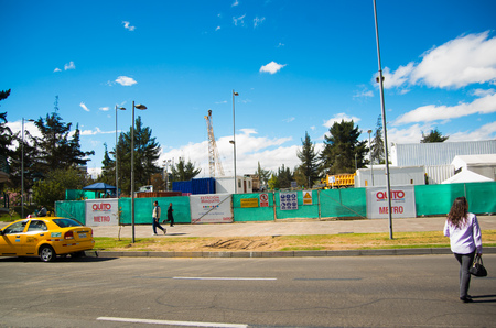 casa colonial: QUITO, ECUADOR - MAY 06 2016: Unidentified woman crossing the mainstreet in NNUU avenue with some construction structure in front, cars and people in the city of Quito Editorial
