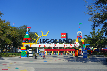 HOUSTON, USA - JANUARY 12, 2017: Legoland sign in the main entrance to Legoland with some people in the enter. Legoland is a theme park based on the popular LEGO brand of building toys