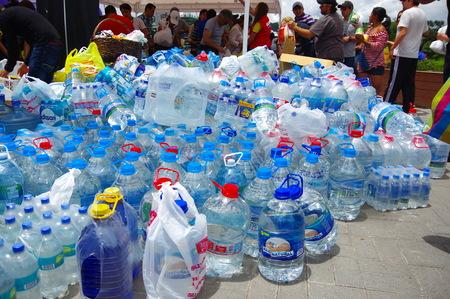 fema: Quito, Ecuador - April,17, 2016: Unidentified citizens of Quito providing disaster relief water for earthquake survivors in the coast. Editorial