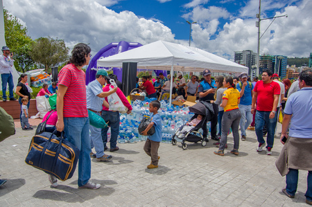Quito, Ecuador - April,17, 2016: Unidentified citizens of Quito providing disaster relief food, clothes, medicine and water for earthquake survivors in the coast. Gathered at la Caolina Park.