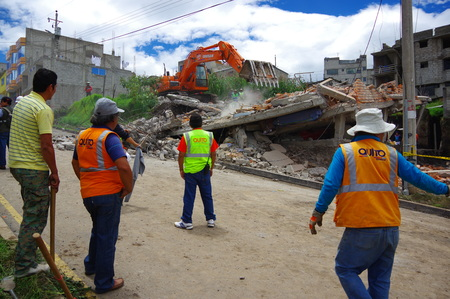 Quito, Ecuador - April,17, 2016: House destroyed by Earthquake with rescue team and heavy machinery in the south part of the city, no casualties.