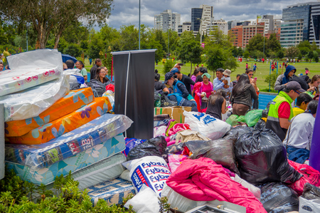 korat: Quito, Ecuador - April,17, 2016: Unidentified citizens of Quito providing disaster relief food, clothes, medicine and water for earthquake survivors in the coast