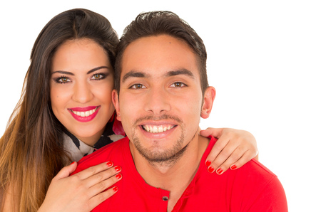 Close up of happy couple isolated on white background. Attractive man and woman being playful