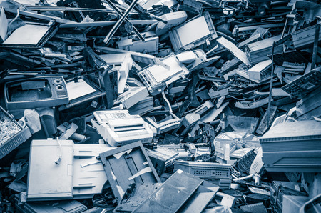 Heap of old scrap metal mainly consist of household appliance in a scrap yard Foto de archivo